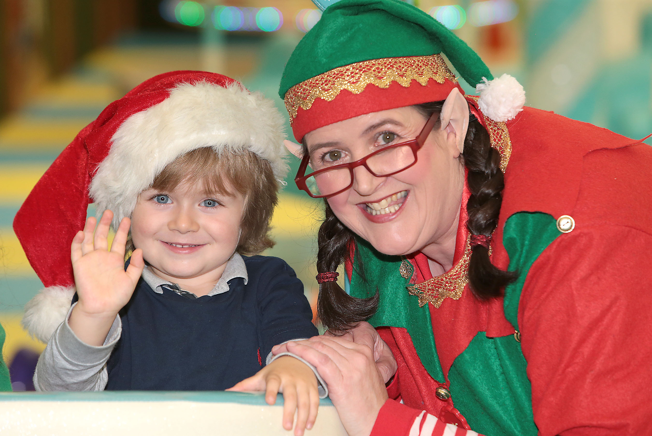 Twitter sensation Theo Horan, four-year old nephew of Niall Horan pictured with  elve Maeve Kerrigan aka Spinners O'Shaughnessy announcing details of  Santa's Cove in Liffey Valley Shopping Centre Dublin.  The ultimate magical Santa experience boasting the top of the range and exclusive Naughty or Nice Machine which opens on 19th November 2017. For more info check out : www.santascove.eu Picture Brian McEvoy No repro fee for one use   Theo was joined by elve Maeve Kerrigan aka Spinners O'Shaughnessy and children from a local Irish Autism Action group who will be among the first visitors to enjoy one of the exclusive sensory sessions for children with special needs at Santa's Cove when it opens on 19th November 2017. Advance booking is advised see www.santascove.eu     Santa's Cove at Liffey Valley promises to be the 'Naughty or Nice' Christmas experience of 2017. As the world's population grows bigger and bigger, Santa's elves are under increasing pressure to make more innovative and interesting toys and decorations for children each Christmas. After months of searching the globe high and low, Santa's most trusted helpers Fidget McPhee and Spinners O'Shaughnessy have found the perfect location for Santa's Cove, an enchanted wonderland where children can help create toys. They'll also get the opportunity to meet Santa and find out how good they've been this year thanks to a marvellous invention, the 'Naughty or Nice Machine' which will be located exclusively at Liffey Valley, Dublin from Sunday 19th November to 24th December 2017.