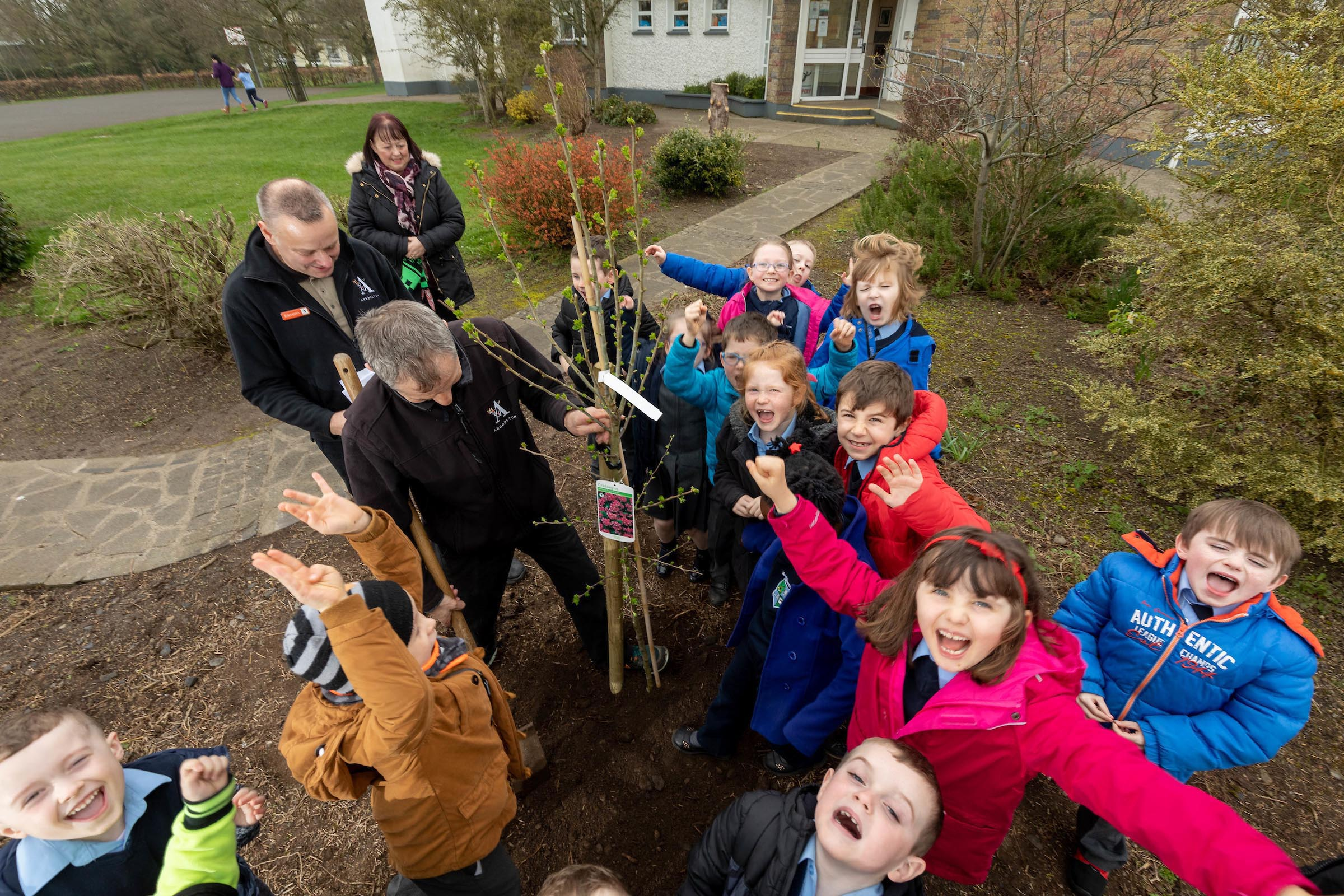 "Eamonn Wall of Arboretum Garden Centre in Carlow planting the first tree at Leighlinbridge National School to launch the Arboretum ""We only have one planet' campaign with principle Orfhlaith Mealy  and pupils from the senior infants class. for further information please contact Sarah Corr  01 6789888  O'Leary PR"