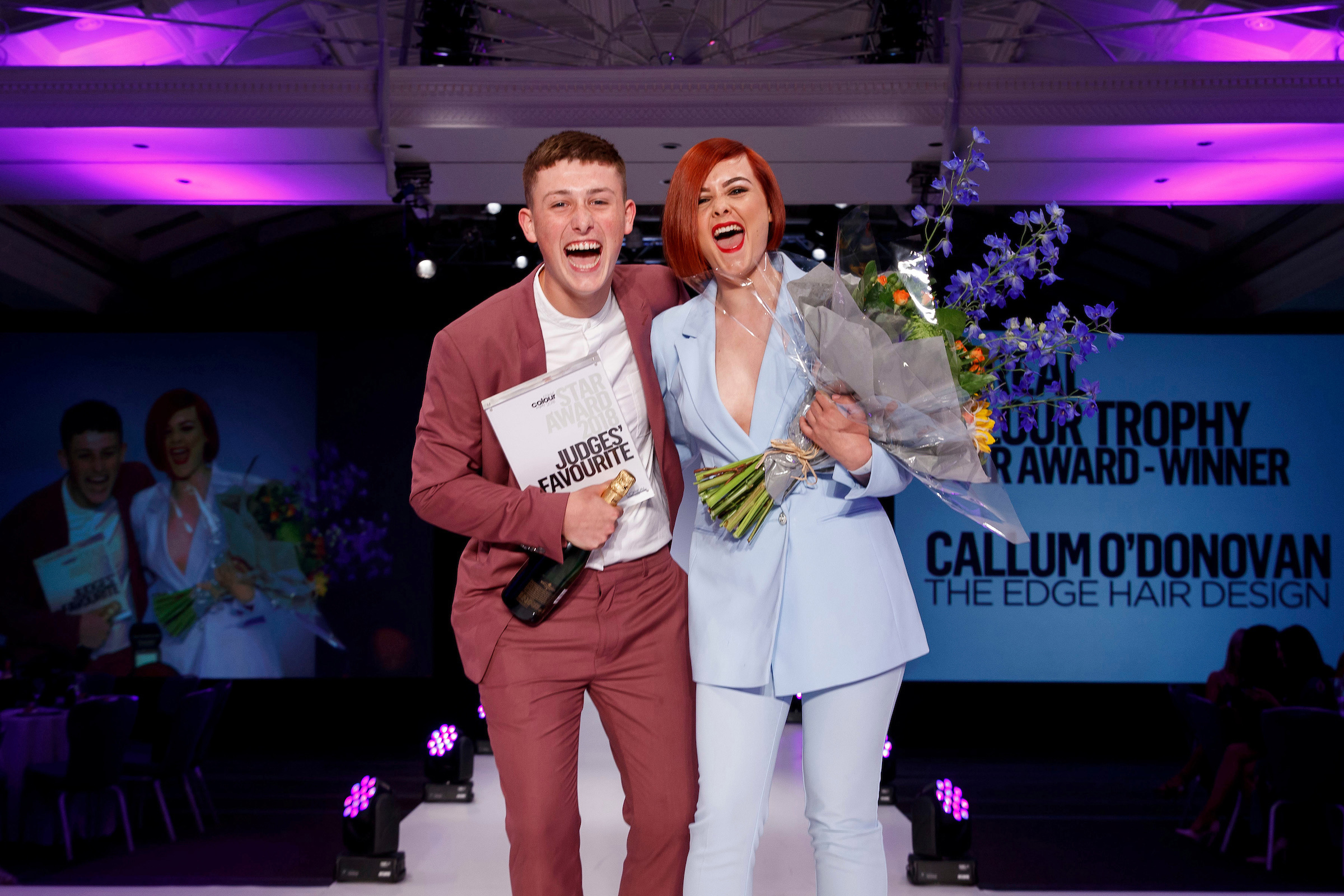 Repro Free: 02/07/2018  Callum O'Donovan of The Edge Hair Design, Cork winner of the L'OrÈal Colour Trophy STAR Award pictured with model Doireann Murphyl at the L'OrÈal Colour Trophy Grand Final 2018 at the Clayton Hotel Dublin.  For further information please contact marioleary@olearypr.ie   01-6789888    Picture Andres Poveda Photography